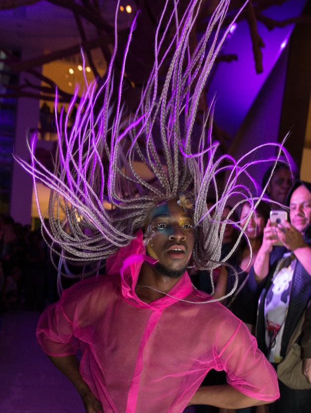 Dancers in pink light