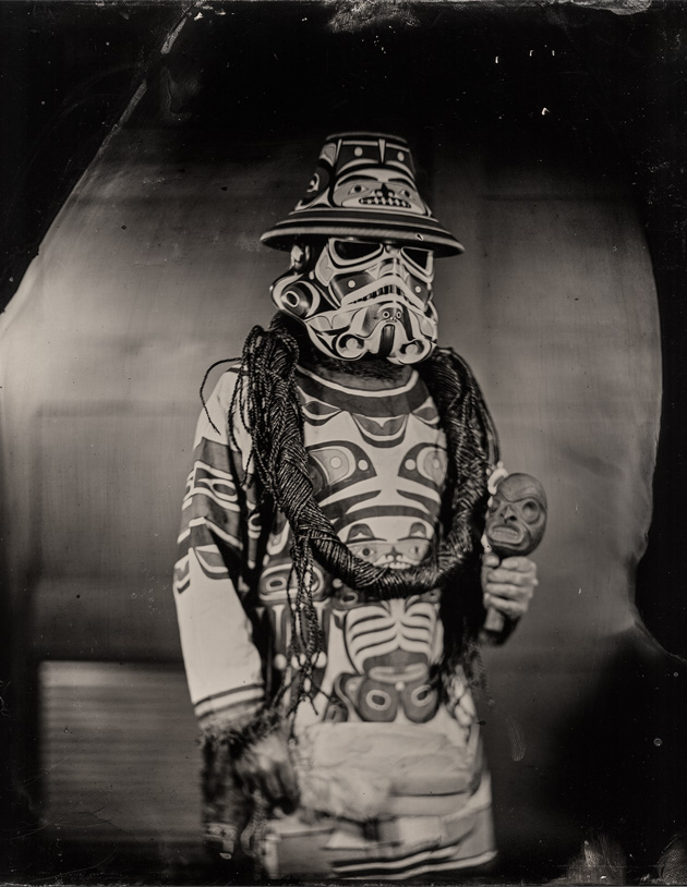 Photo of a man dressed in a stormtrooper costume that's been painted in native american designs