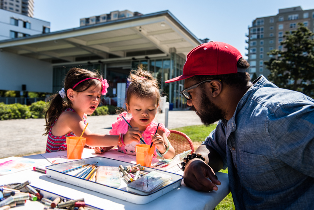 Photo of a Father and his two daughters working on an art project at the Olympic Sculpture Park