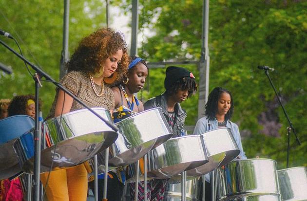 Women around a pan steel drum