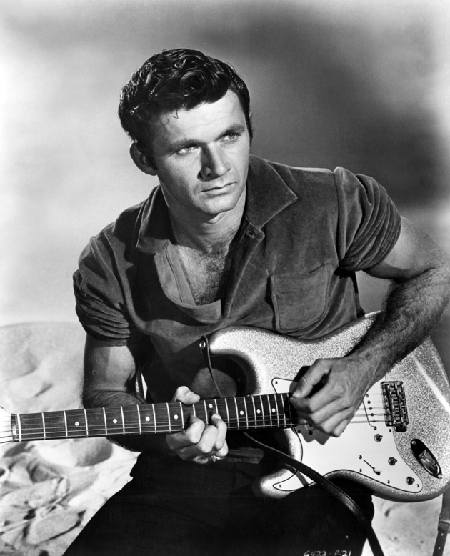 black and white portrait of Dick Dale holding his guitar